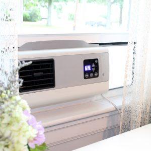 Cape BreeZ filtering window fan installed in bedroom