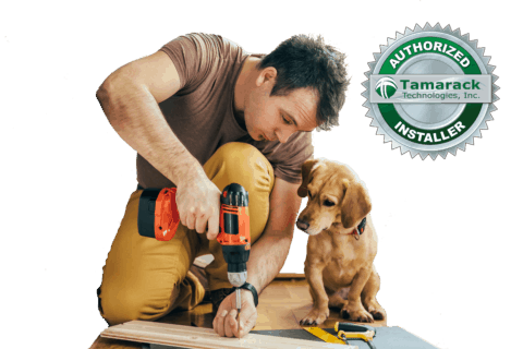 Qualified Tamarack Technologies Installer Contractor With Dog Working with Drill in Customers Attic