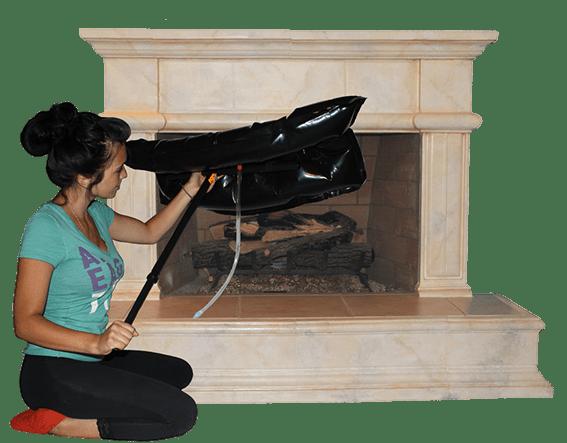 Fireplace Plug Woman Installing Inflated Fireplug to Save On Her Energy Heat Bill Main Image
